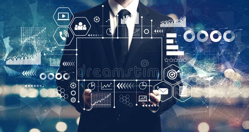 Marketing concept with businessman holding a tablet stock image