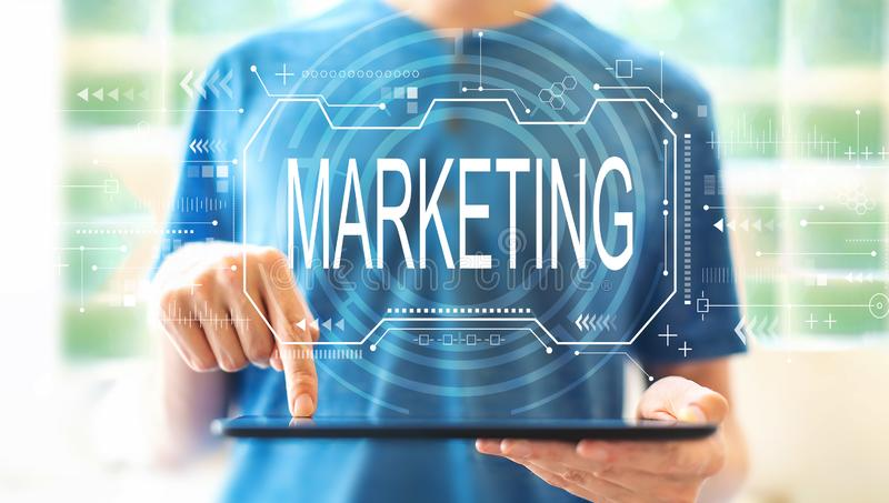 Marketing concept with man using a tablet royalty free stock images