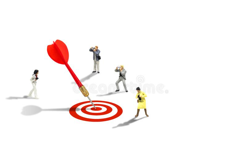 Photographers taking photograph red dart hit target on dartboard isolated on white background. Marketing Concept : Miniature figurine character as photographers stock photos