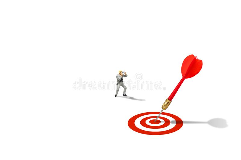 Photographers taking photograph red dart hit target on dartboard isolated on white background. Marketing Concept : Miniature figurine character as photographers royalty free stock photos