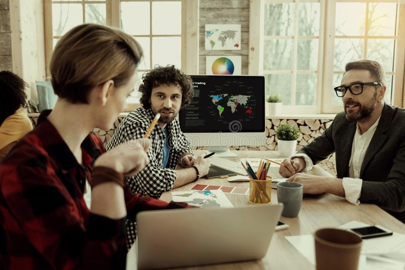 Marketing department staff producing ideas for advertisement royalty free stock photography