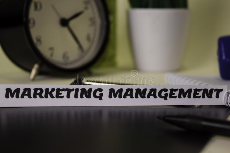 Marketing Management on the paper isolated on it desk. Business and inspiration concept stock image