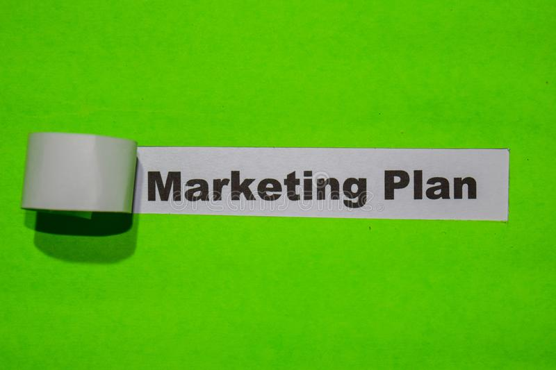 Marketing Plan, business concept on green torn paper stock photo