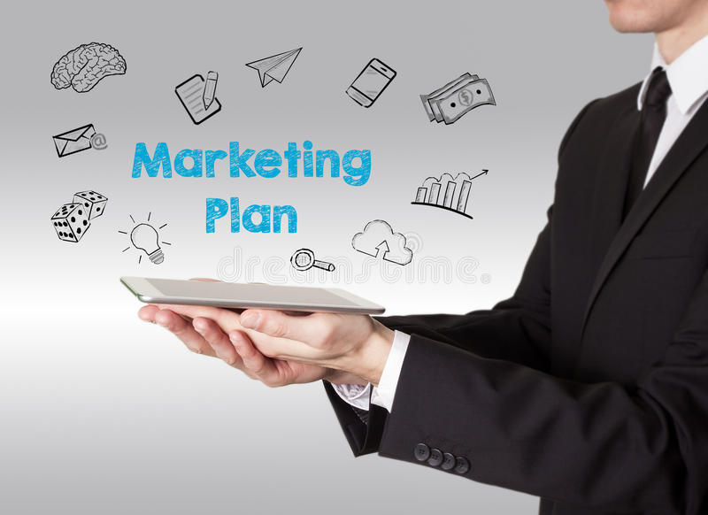 Marketing Plan concept, young man holding a tablet computer stock images
