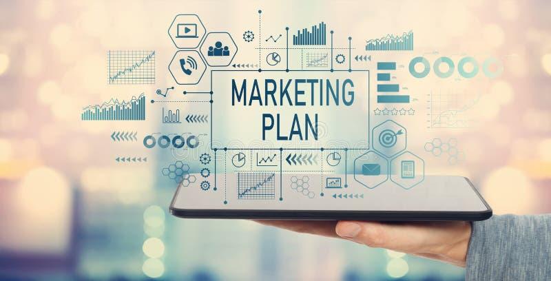 Marketing plan met tabletcomputer stock fotografie