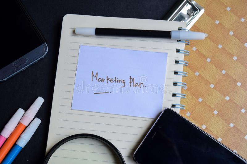 Marketing plan word written on paper. marketing plan text on workbook, technology business concept stock images