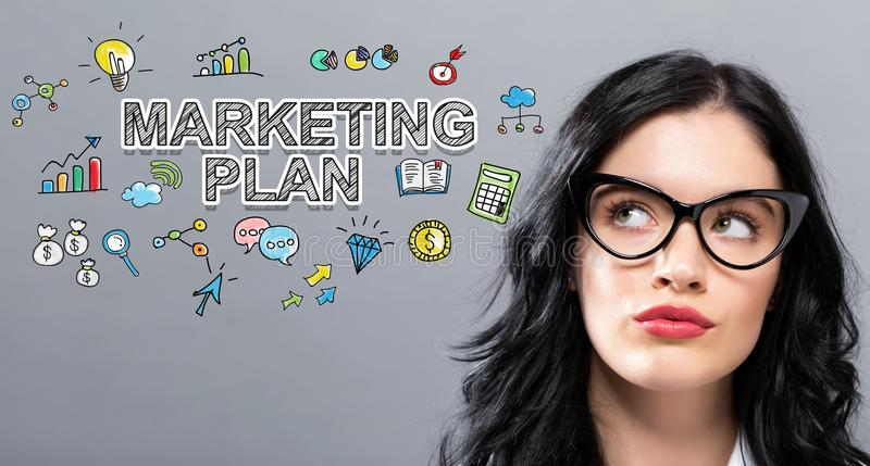 Marketing Plan with young businesswoman stock photo