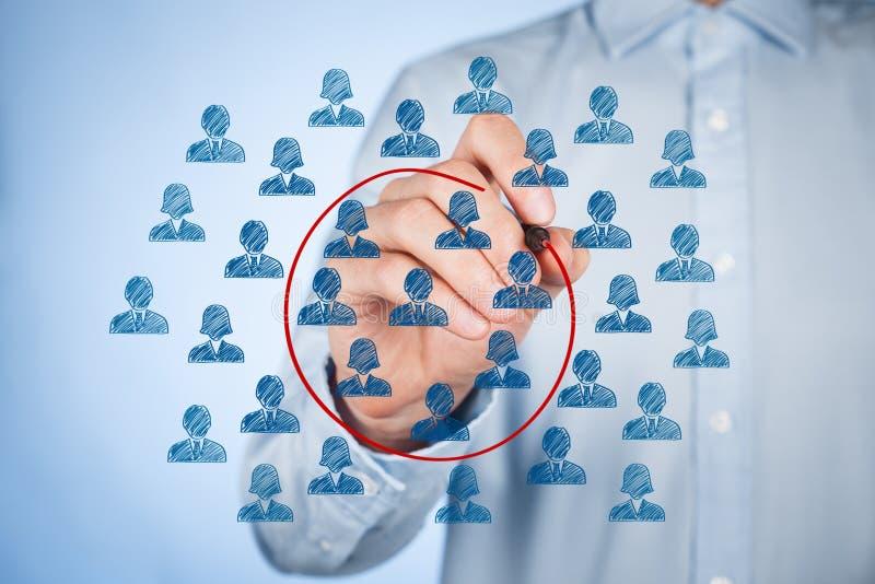 Marketing segmentation. Concept - businessman with select segment (niche) of customers royalty free stock photo