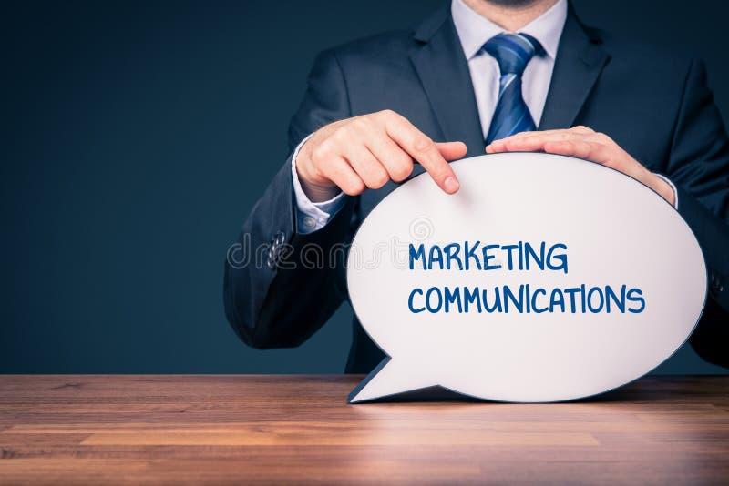 Marketing communications concept. Marketing specialist with marketing communications text on speech bubble stock photography