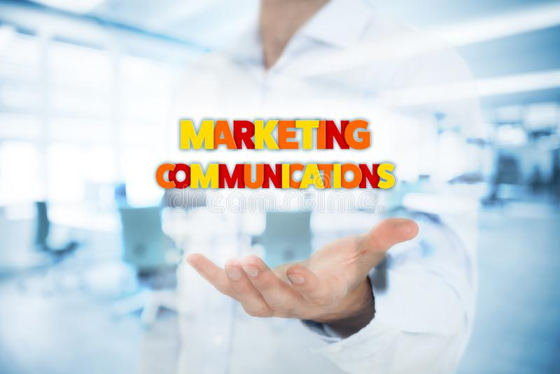 Marketing communications concept. Marketing specialist with marketing communications text stock photo