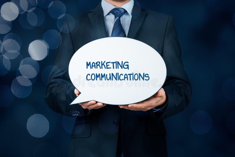 Marketing communications concept. Marketing specialist with marketing communications text on speech bubble royalty free stock photos