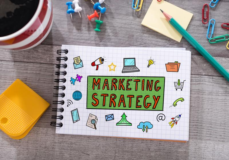 Marketing strategy concept on a notepad. Marketing strategy concept drawn on a notepad placed on a desk royalty free stock photography