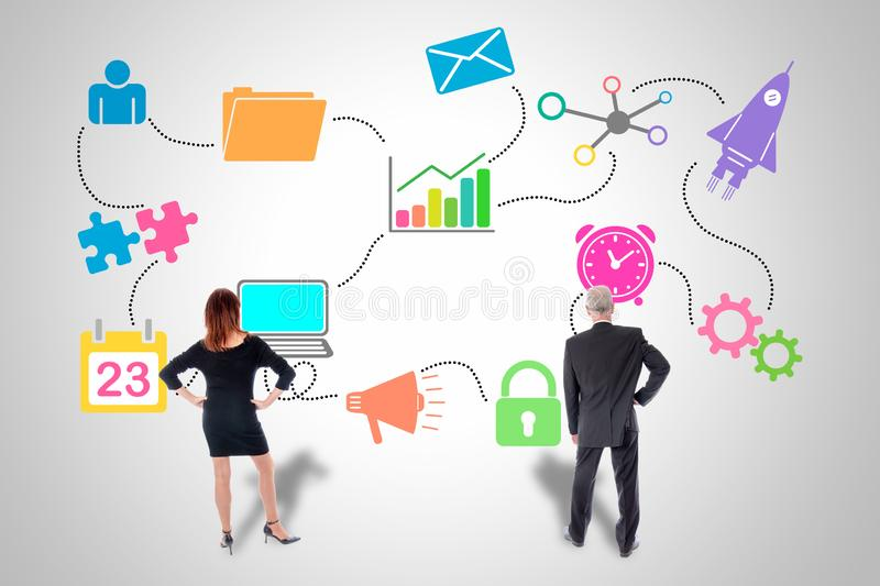 Marketing strategy concept watched by business people. Marketing strategy concept drawn on a wall watched by business people royalty free stock photos