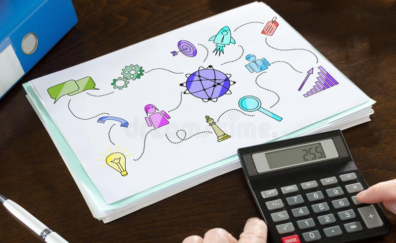 Marketing strategy concept illustrated on a paper. With a calculator stock image