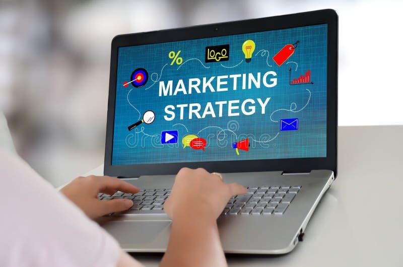 Marketing strategy concept on a laptop. Woman using a laptop with marketing strategy concept on the screen stock photos