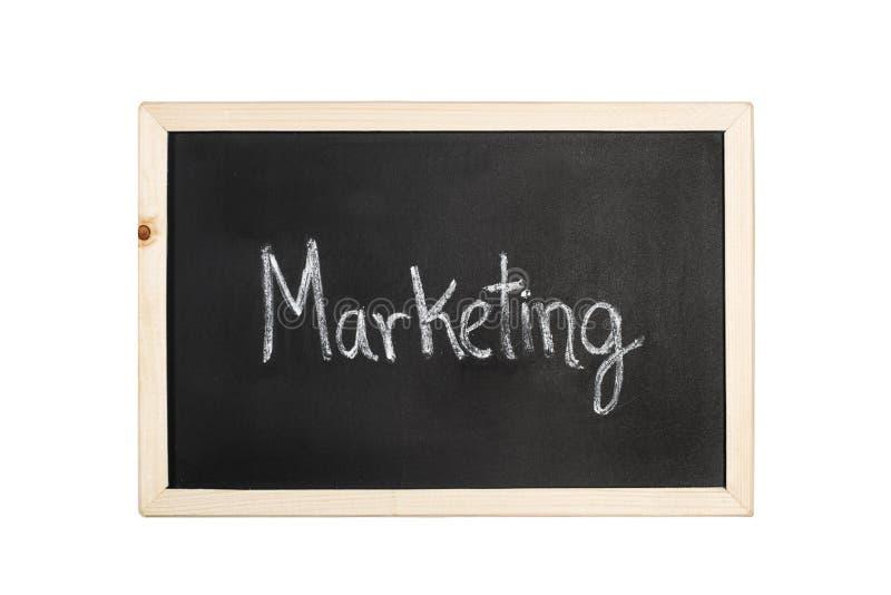 Marketingowy słowo pisze w kredzie na blackboard zdjęcie stock