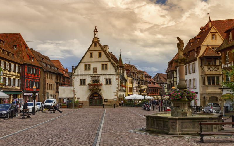 Marketplace in Obernai village, Alsace, France. Marketplace in Obernai village with Saint-Odile fountain, the wheat hall, Alsace, France stock images