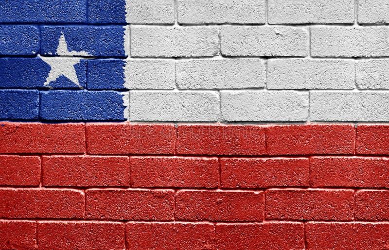 Markierungsfahne von Chile auf Backsteinmauer stockfotografie