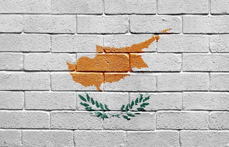 Markierungsfahne von Zypern auf Backsteinmauer lizenzfreies stockfoto