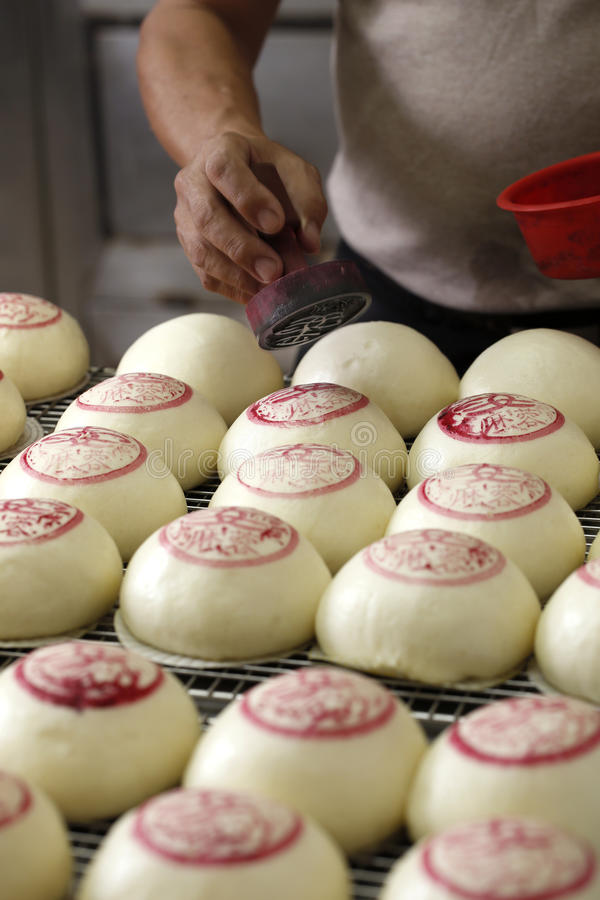 Marking red notes on chinese dumpling before baking royalty free stock photo