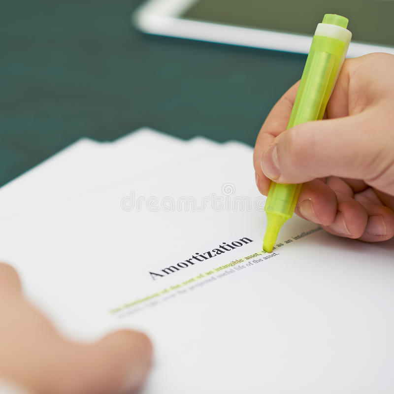 Marking words in an amortization definition stock photography