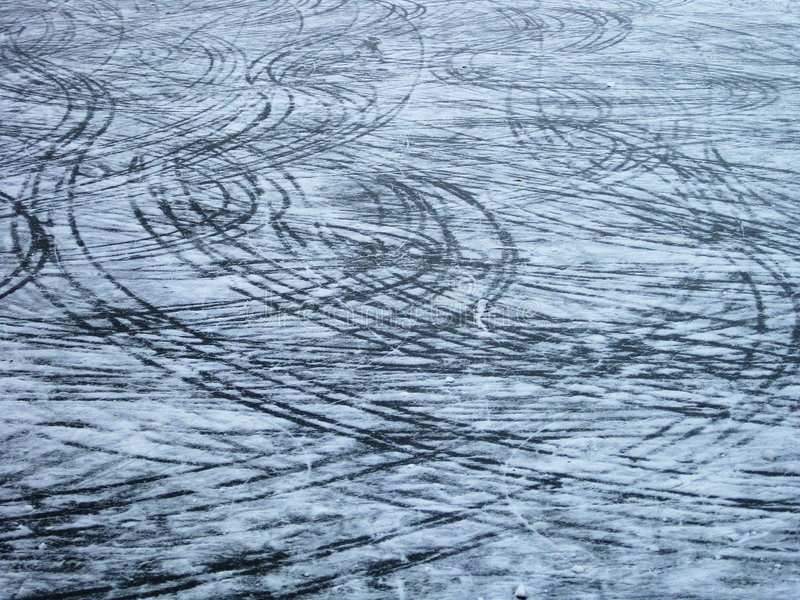 Marks on the ice. Trails made by sledge on icebound pond stock photos