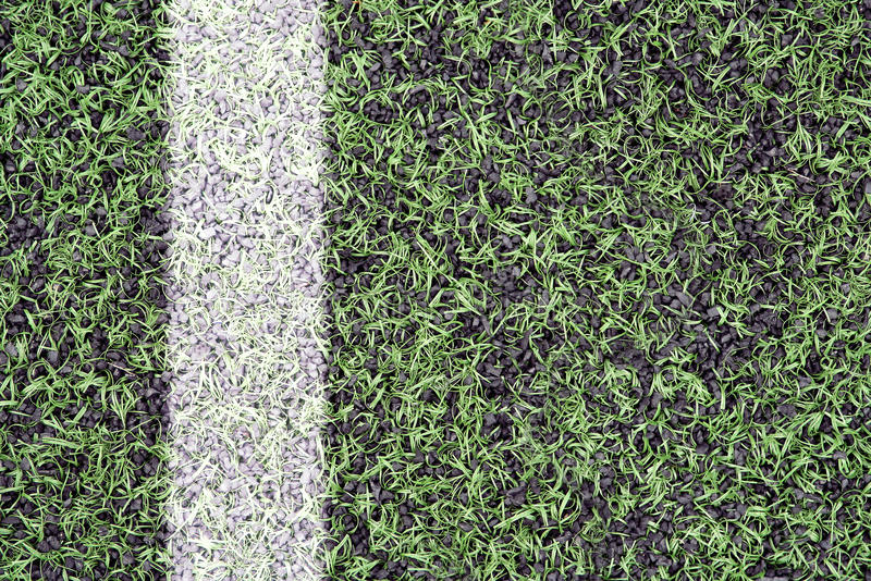 Marks on sports turf. Detail of the cover of artificial sports turf with markings royalty free stock image