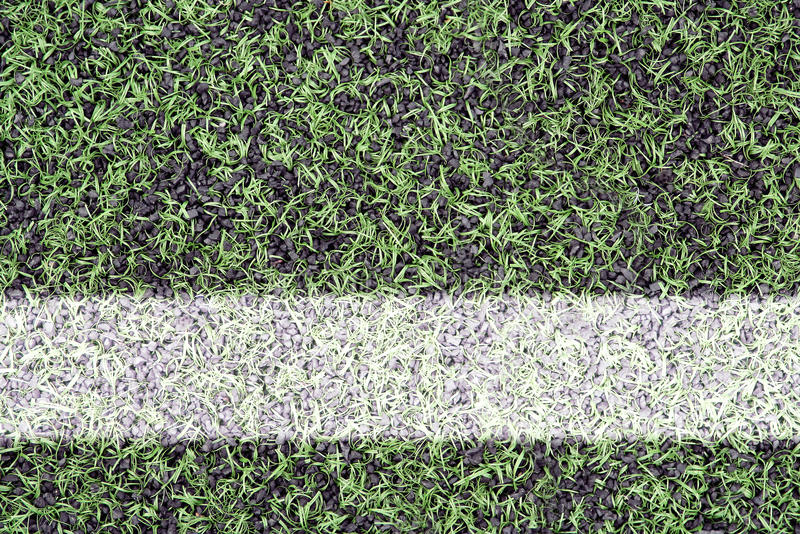 Marks on sports turf. Detail of the cover of artificial sports turf with markings stock photo