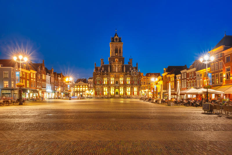 Markt square at night in Delft, Netherlands. City Hall and typical Dutch houses on the Markt square in the center of the old city at night, Delft, Holland stock image