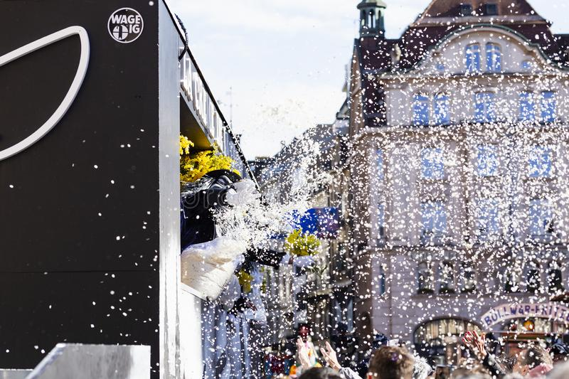Basel carnival 2019 confetti rain. Marktplatz, Basel, Switzerland - March 13th, 2019. A waggis throws confetti from his carnival float into the watching crowd royalty free stock images