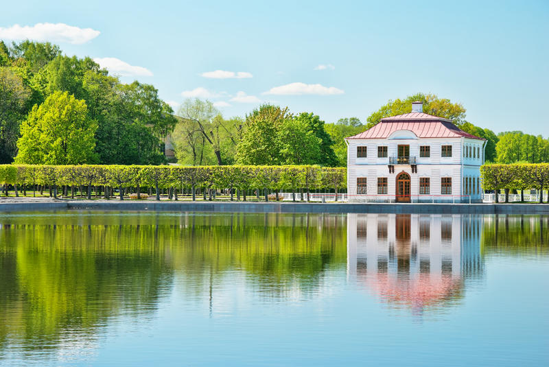 Marly palace on the bank of pond in peterhof. In russia stock images