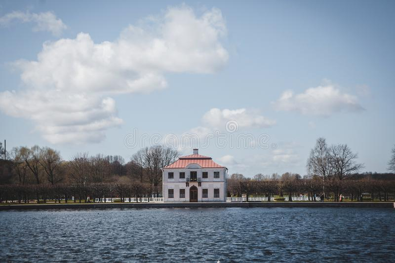 The Marly Palace in the Peterhof, built in 1723. The Marly Palace and ornamental ponds in the lower Park of Peterhof. The Peterhof Palace included in the UNESCO royalty free stock photography