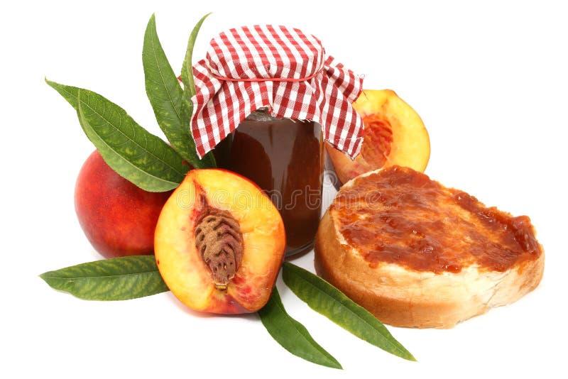 Marmalade. Peach marmalade isolated on white royalty free stock photos