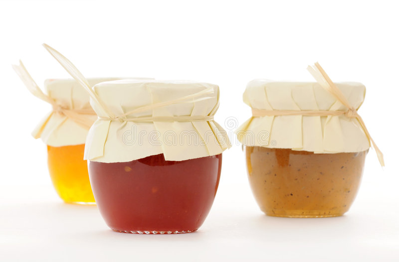 Marmalade. Containers with marmalade on white stock photo