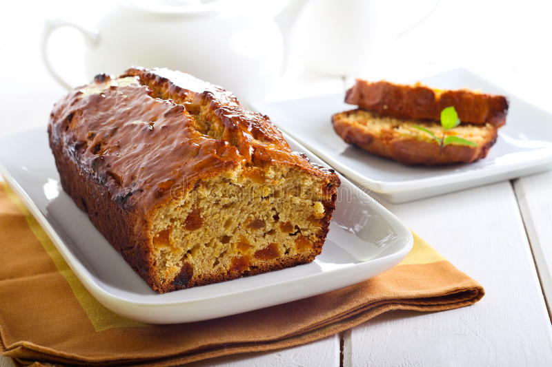 Marmalade and apricot tea bread. On plate stock photography