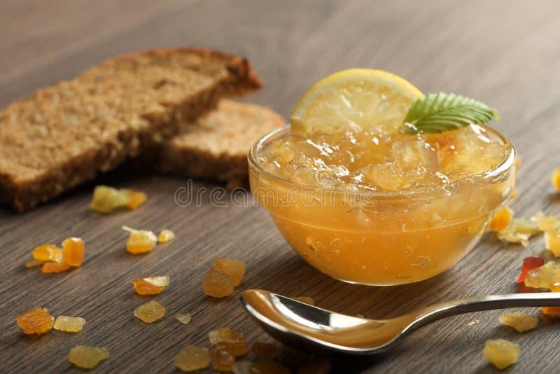 Marmalade lemon. Homemade lemon marmalade on a wooden background stock photos