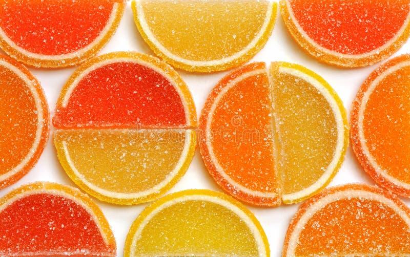 Marmalade. Lemon, orange and grapefruit slices, background, close-up royalty free stock photo