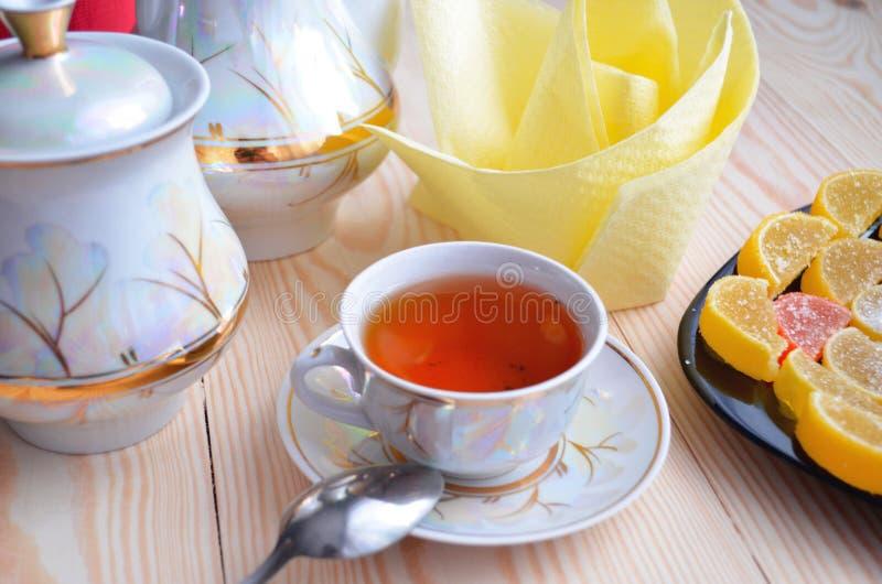 Marmalade and tea. Marmalade and tea on white table background stock photo