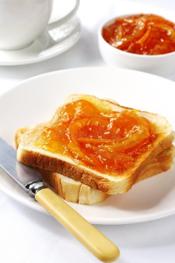 Marmalade on Toast. Breakfast of orange marmalade on toast, with bone-handled knife stock photography