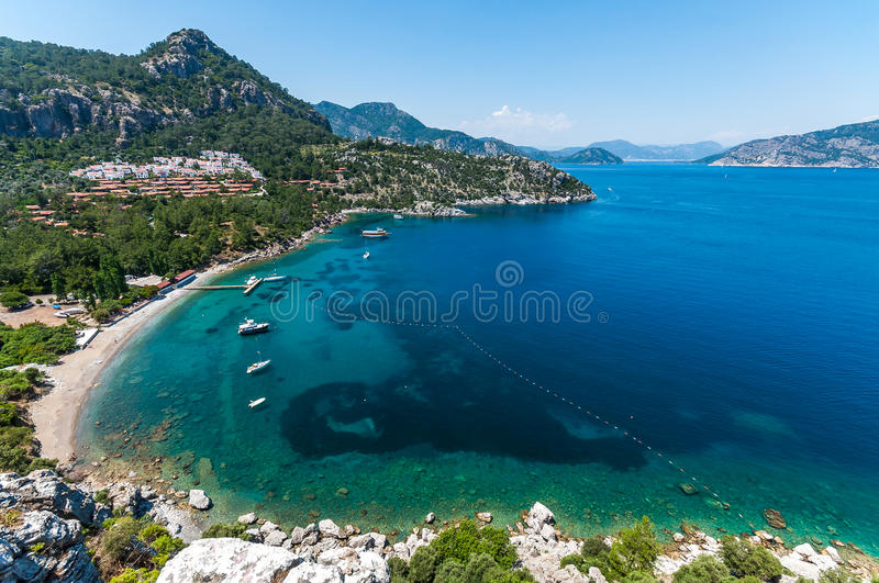Marmaris, Turkey. Marmaris lies in a bay with crystal-clear water. Just for emphasis: Marmaris lies in a bay with crystal-clear water. This is where the