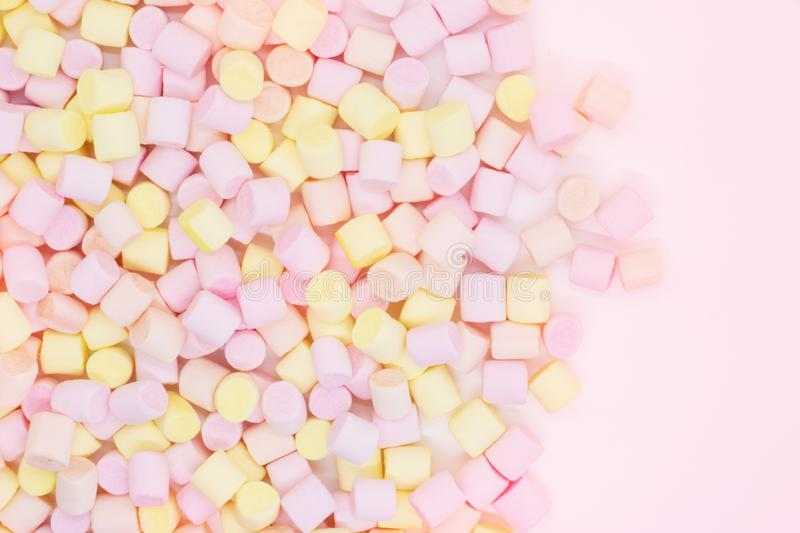 Marmellow air marshmallow close-up on a pink background, pastel colors, light dessert, place for text royalty free stock image