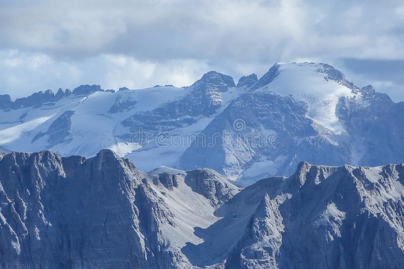 Marmolada glacier on the rugged mountain landscape stock photography