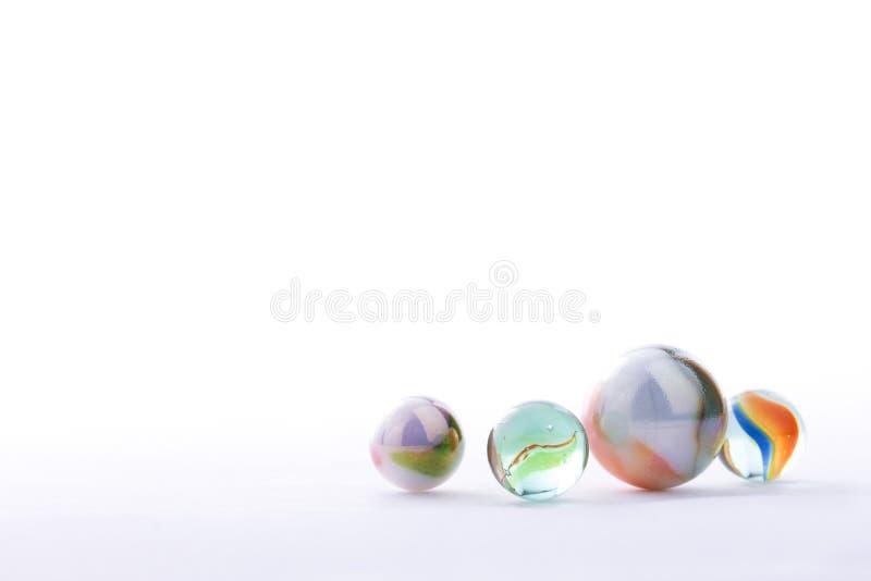 Marmorbollar som isoleras på vit bakgrund royaltyfri fotografi
