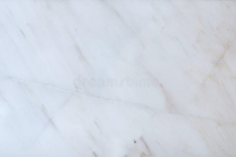 Marmorera stenbakgrund med beige och vit abstrakt färger och textur, golvet eller väggdesigne och garnering Naturmodell arkivfoto