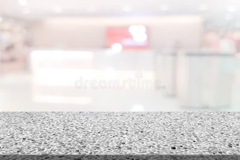 Marmortabelle mit undeutlichem Hintergrund des Registerzählers lizenzfreie stockbilder