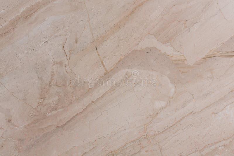 Marmurowy tło w delikatnym jasnobrązowym brzmieniu zdjęcie royalty free