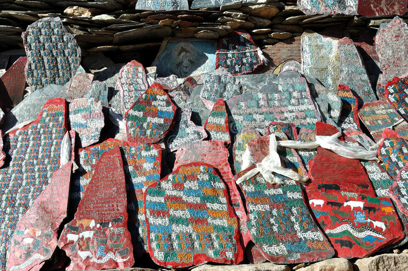 Stones for Praying. Marnyi stones(prayer stones)are carved with prayers or auspicious patterns and considered shrine objects by pilgrims in Tibet royalty free stock image