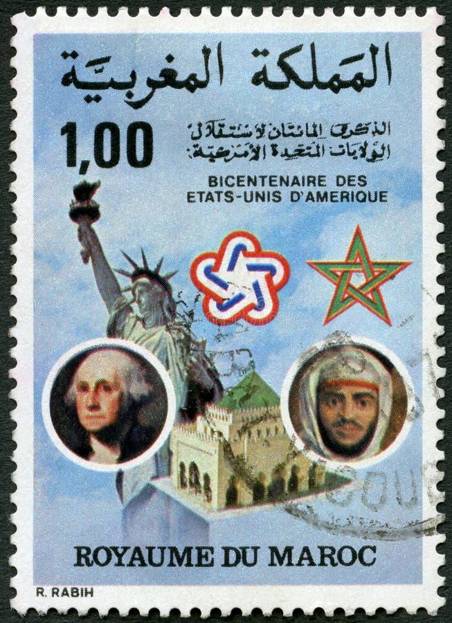MAROC - 1976 : spectacles Statue de la Liberté, George Washington 1732-1799 et Palais Royal Rabat, roi Hassan 1929-1999 images stock