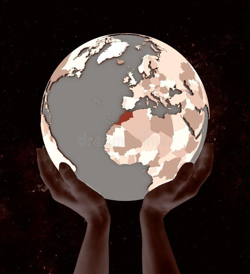 Marocko på jordklotet i händer royaltyfri illustrationer