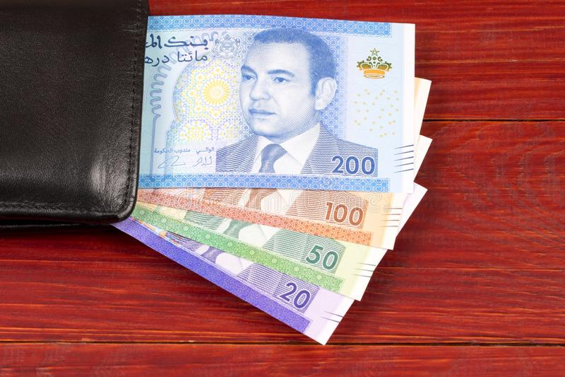 Marokkaans geld in de zwarte portefeuille stock fotografie